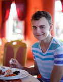 Handsome teenager in a restaurant Stock Photo
