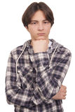 Handsome teenager thinking Royalty Free Stock Photography