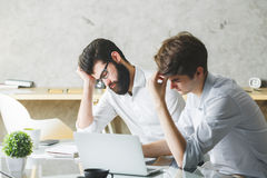 Handsome tired men at work Royalty Free Stock Image