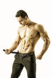 Handsome topless muscular man undressing, isolated Royalty Free Stock Photography