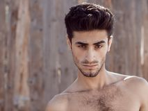Handsome topless young man outdoors Stock Image