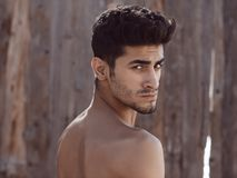 Handsome topless young man outdoors Stock Photos