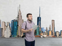 A handsome tourist in casual clothes is trying to find the best tourist place.  Stock Photos