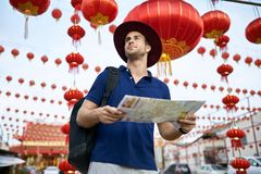 Traveler on asian city street. Daylight shooting. royalty free stock images