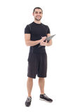 Handsome trainer in sportswear with clipboard isolated on white Royalty Free Stock Photography