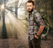 Handsome traveler in autumnal forest Stock Images