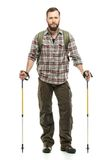 Handsome traveler with hiking poles Royalty Free Stock Photos