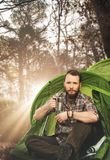 Handsome traveler near tent with Stock Images