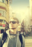 Handsome traveler with sunglasses on street. Urban Traveler Vaca Stock Photos