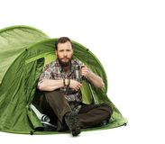 Handsome traveler in a tent Stock Photography