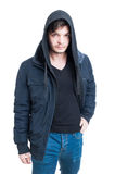 Handsome trendy male wearing hooded sweatshirt, black jacket and. Jeans as stylish clothing concept isolated on white background Stock Photo