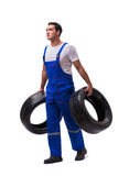 The handsome tyre repairman isolated on white Royalty Free Stock Photos