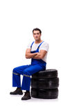 The handsome tyre repairman isolated on white Stock Photo