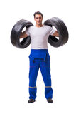The handsome tyre repairman isolated on white Royalty Free Stock Photo