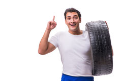 The handsome tyre repairman isolated on white Royalty Free Stock Images