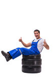 The handsome tyre repairman isolated on white Stock Photography