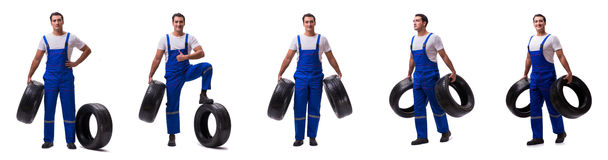 The handsome tyre repairman isolated on white Stock Image
