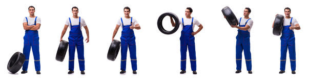 The handsome tyre repairman isolated on white Stock Photos