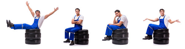 The handsome tyre repairman isolated on white Royalty Free Stock Image