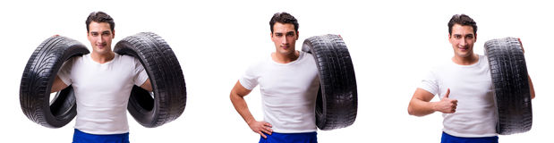 The handsome tyre repairman isolated on white Royalty Free Stock Photography