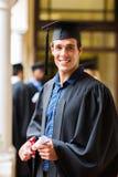 Handsome university graduate. On graduation day Royalty Free Stock Photos
