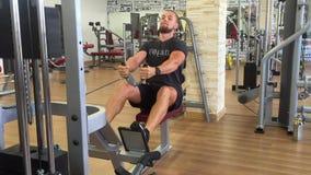 Handsome Vegan Bodybuilder Trains His Back on Workout Equipment. HD. stock video
