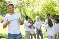 Handsome volunteer showing thumbs up Royalty Free Stock Photos