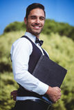 Handsome waiter holding menus Royalty Free Stock Photos