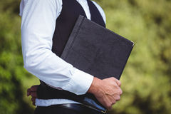 Handsome waiter holding menus Stock Photography