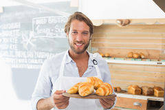 Handsome waiter holding tray of croissants Royalty Free Stock Photography