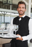 Handsome waiter holding tray of wineglasses Royalty Free Stock Images