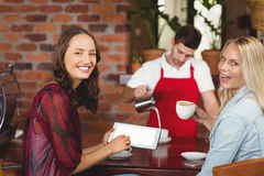 Handsome waiter preparing a cup of coffee. At the coffee shop Stock Photo