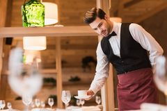 Waiter serving cup of coffee stock image