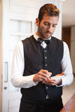 Handsome waiter taking an order. In a fancy restaurant Royalty Free Stock Image