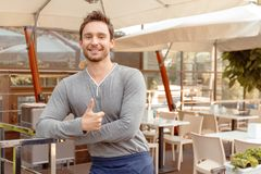 Handsome waiter with thumbs up Stock Photography