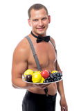 Handsome waiter with a tray of fruit Stock Photos