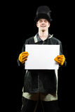 Handsome welder holding a blank form. isolated on. Welder holding a blank form. isolated on black background Stock Photo
