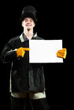 Handsome welder holding a blank form. isolated on Royalty Free Stock Photo