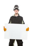 Handsome welder holding a blank form. isolated on Royalty Free Stock Image