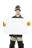 Handsome welder holding a blank form. Welder holding a blank form. on white background Stock Photo
