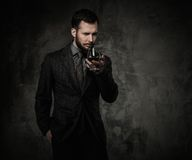 Handsome well-dressed with drink royalty free stock photo