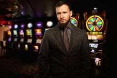 Handsome well-dressed man in casino Royalty Free Stock Photo