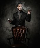 Handsome well-dressed man smoking Stock Photography