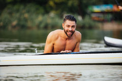 Handsome wet man on paddleboard Royalty Free Stock Photos