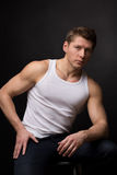 Handsome in white undershirt. Young handsome in white undershirt on grey stock images