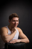 Handsome in white undershirt. Young handsome in white undershirt on grey stock photo