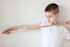 Handsome White Young Boy Holding a Meter Stick Stock Image