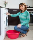 Handsome woman doing laundry Royalty Free Stock Photography