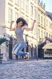 Handsome woman jumping in the street Royalty Free Stock Images