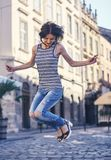 Handsome woman jumping in the street Stock Image
